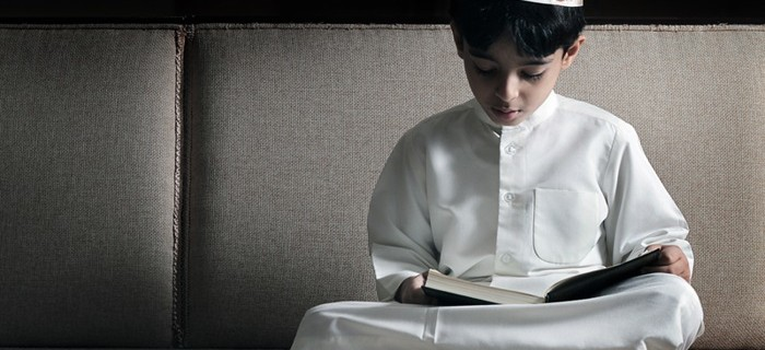 muslim-boy-reading-the-quran