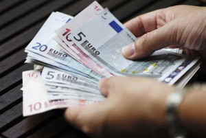 Woman counting money, Euro banknotes