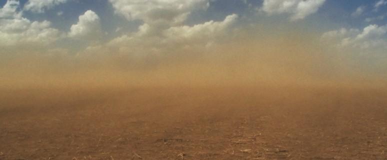 dust-storm-roars-across-field-P